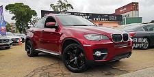 23800 BMW X6 xDrive 35i E71 2008 红色宝马4人座X6